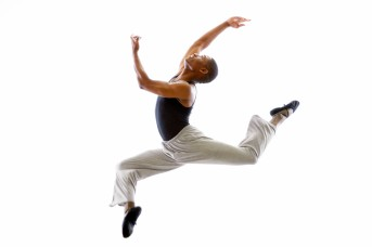 Ballet Dancer Mid-air in Jump --- Image by © Royalty-Free/Corbis